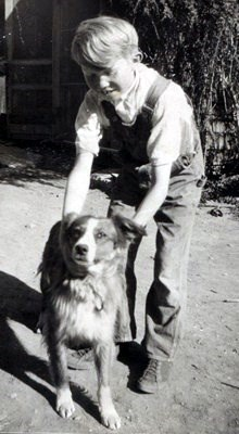 10 year-old Bert with cow dog Jim 1937