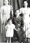 Our mother as a little girl with her mother and sisters.
